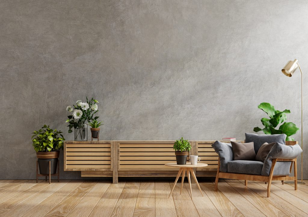 Cabinet for TV in modern living room with armchair,lamp,table,flower and plant on concrete wall background.